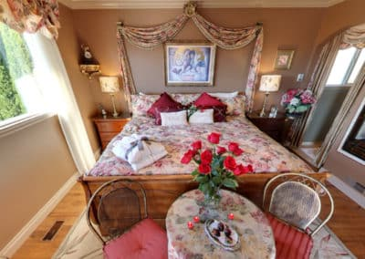 The Regal Jacuzzi Suite, Fit for a  King & Queen, is the Perfect Place to Have Roses Waiting to Surprise Your Sweetheart at A Vista Villa Couples Retreat in Kelowna, BC