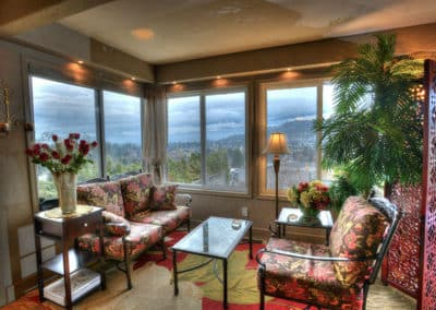 A VIP Guest Lounge has Stunning Views of Okanagan Lake, the City of Kelowna, The Kelowna Golf & Country Club and the Mountains at A Vista Villa Couples Retreat in Kelowna, BC