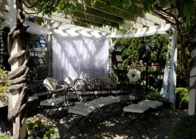 wedding guests enjoy outdoor gazebo gardens